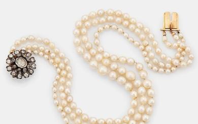 A three strand cultured pearl necklace with a clasp in 18K gold and silver set with rose- and old-cut diamonds