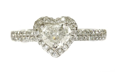 A white gold heart cut diamond halo cluster ring