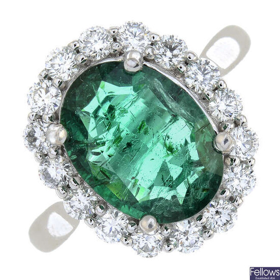 An 18ct gold emerald and brilliant-cut diamond cluster ring.