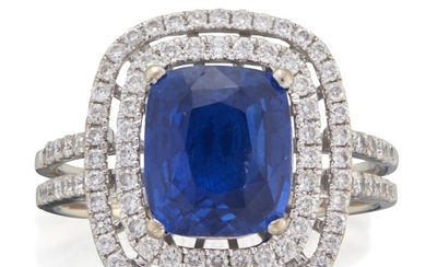 An eighteen karat white gold, sapphire, and diamond ring...