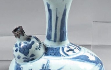 Chinese porcelain kendi with silver frames. Wanli porcelain (1573-1619), silver frames 800°/°°° posterior, foreign work. Of globular shape, with blue-white turning decoration of Chinese characters in a landscape, braid and frieze of leaves on the neck...