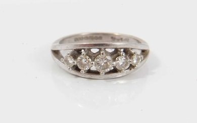 Diamond five stone ring with five graduated brilliant cut diamonds in claw setting within a white gold border on plain shank. Signed 'Starlight', hallmarked Birmingham 1994, ring size Q½. Estimated...
