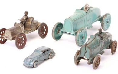 FOUR CAST IRON TOY CARS