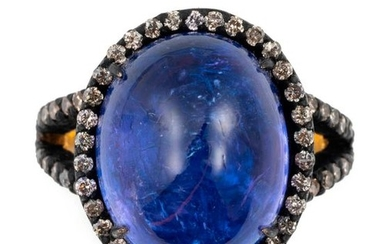 Gold and silver ring set with a tanzanite...