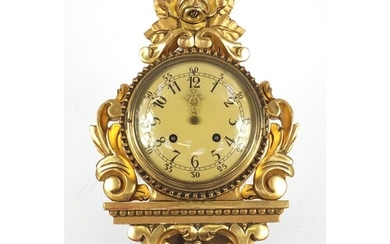 Ornate gilt wood cartel type clock with Arabic numerals, 49c...