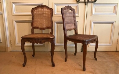 """Pair of Queen chairs with cane base in natural wood molded and carved with acanthus, shells and leather. They stand on arched legs joined by an """"X"""" spacer."""