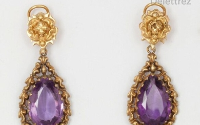 Pair of chased yellow gold earrings, each adorned with a pear-shaped amethyst. P. Gross: 12.7g.