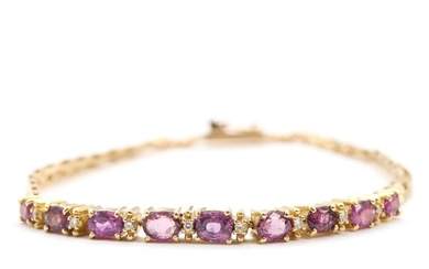Ruby and diamond bracelet set with numerous faceted rubies and brilliant-cut diamonds, mounted in 18k gold. L. 20.5 cm. Weight app. 12.5 g.