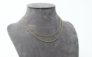 Set of two 18K (750) yellow gold necklaces with ball link.