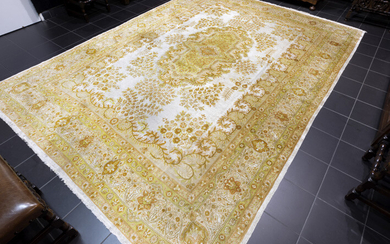 Signed finely knotted Tabriz in very fine wool...