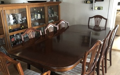 A 20th century English mahogany dining room, consisting a dining table and eight chairs. Hepplewhite style. Table H. 78 cm. W. 100 cm. L. 210 cm. (9)
