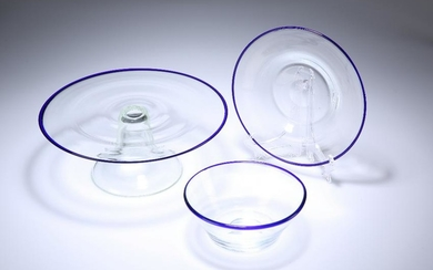 A BLUE-RIMMED GLASS BOWL AND UNDERPLATE, PROBABLY