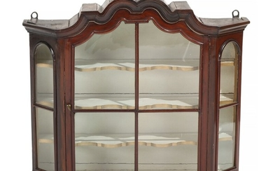 A Baroque walnut wall display cabinet, curved top, front with glass door. 18th-19th century. H. 63. W. 72. D. 20 cm.