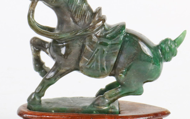 A Chinese Spinach Hardstone Carved Horse