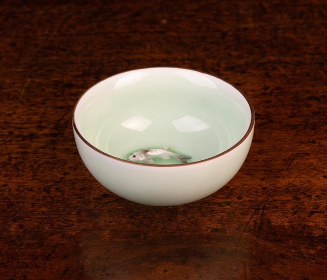 A Miniature Chinese Celadon glazed porcelain bowl with two moulded carp to the bottom, 2¾'' (7.5 cm)