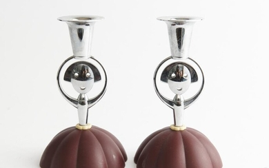 A PAIR OF ALESSI CANDLE HOLDERS, DESIGNED BY ALESSANDRO MENDINI, 1999, H.17CM, LEONARD JOEL LOCAL DELIVERY SIZE: SMALL