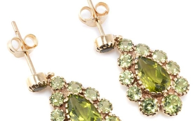 A PAIR OF VICTORIAN STYLE PERIDOT CLUSTER EARRINGS; drop shape clusters each centring a pear cut peridot to surround and stud fittin...