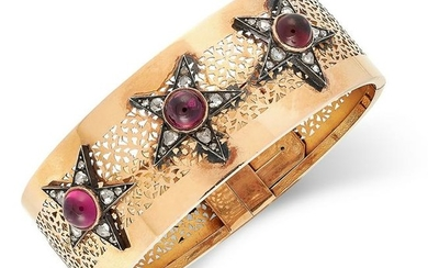 A RUBY AND DIAMOND BANGLE set with cabochon garnets and