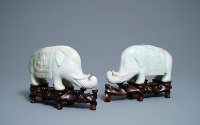 A pair of Chinese jadeite models of elephants,...