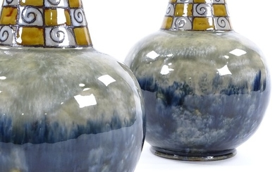 A pair of Royal Doulton squat vases, mottled blue glaze with...