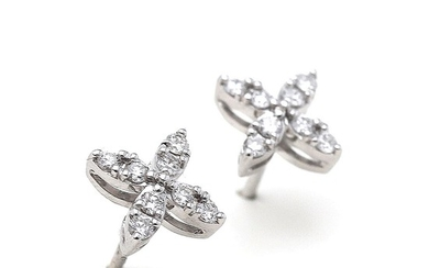 A pair of ear studs each set with numerous brilliant-cut diamonds, mounted on 18k white gold. (2)