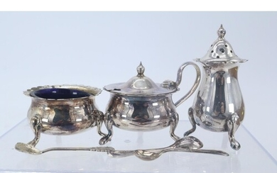 A silver cruet set with blue glass liners, one silver spoon ...