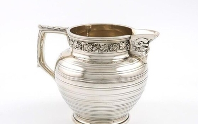 A silver milk jug / small beer jug,...