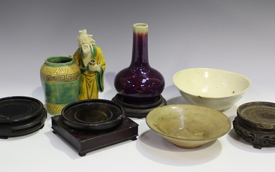A small group of Chinese pottery, including a flambé glazed bottle vase, height 15cm, a sancai