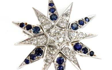 A white gold diamond and sapphire India Star brooch