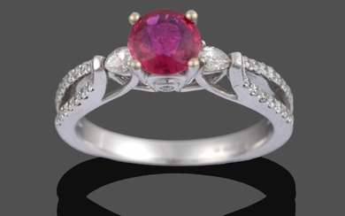 An 18 Carat White Gold Ruby and Diamond Ring, the...