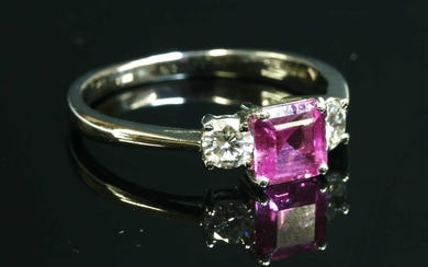 An 18ct white gold three stone pink sapphire and diamond ring