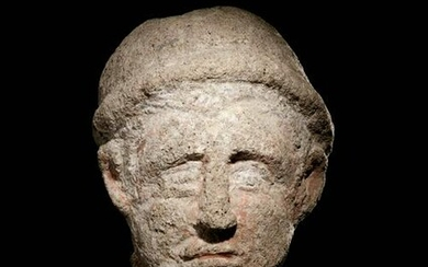 An Etruscan Over-Lifesized Nenfro Portrait Head of a