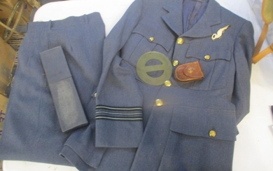 An RAF WWII tunic with observer cloth badge and trousers, a ...