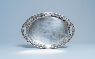 An oval silver tray with incised floral design, Thailand, 19/20th C.
