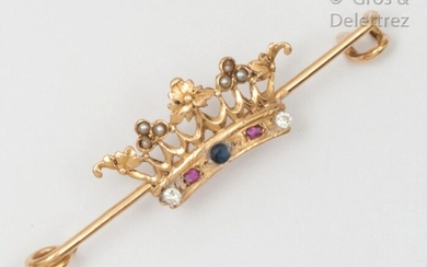 """Barette"""" brooch in yellow gold with a crown decoration, set with coloured stones. Raw weight: 3.4g."""