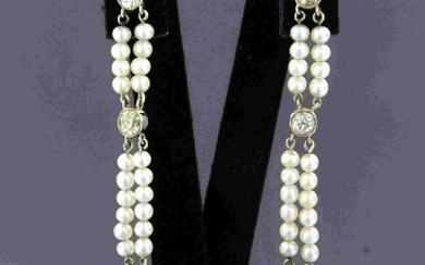 Diamond earrings with pearls