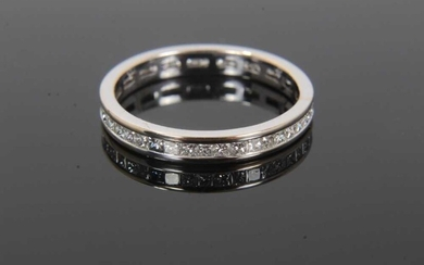 Diamond full band eternity ring with a full band of princess cut diamonds in 18ct white gold channel setting. Estimated total diamond weight approximately 0.50cts. Hallmarked 18ct. Ring size L.