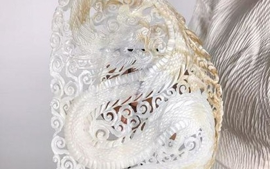 Giant intricately carved Mother of Pearl Shell with
