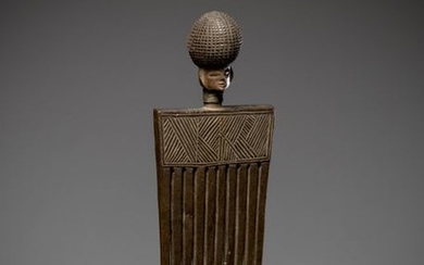 LWENA, Angola. Old comb topped by a finely...