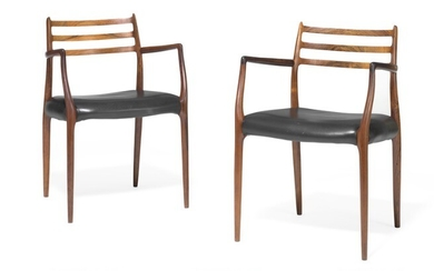 Niels O. Møller: A pair of Brazilian rosewood armchairs. Seat upholstered with black leather. Model 62. Manufactured by J.L. Møller. (2)