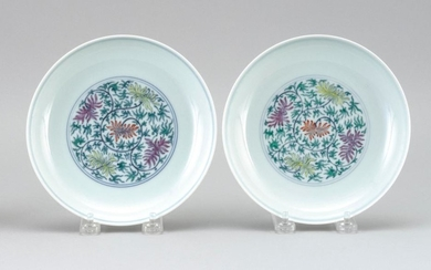 """PAIR OF CHINESE DOUCAI PORCELAIN DISHES With a flower and vine design. Six-character Daoguang mark on base. Diameters 6.9""""."""
