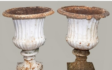 PAIR OF LARGE CAST IRON GARDEN URNS, the fluted body with sc...