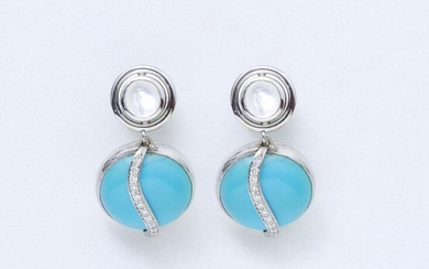 Pair of 750 thousandths white gold earrings holding in pendants a turquoise cabochon applied with an undulating line of brilliant-cut diamonds. The clasp is enhanced by a moonstone cabochon in a closed setting.