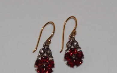 Pair of flower-design drop earrings set with garnets and dia...