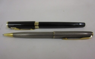 Parker black fountain pen together with a Parker sterling si...
