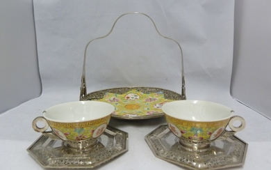 Silver mounted Chinese porcelain - comprising two tea cups a...