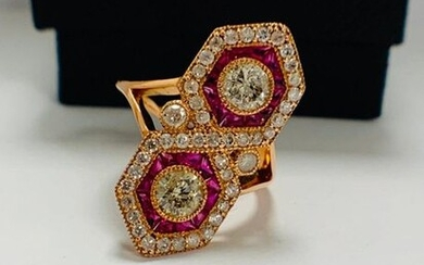 14ct Rose Gold Ruby and Diamond ring featuring centre, 2 round brilliant cut Diamonds (0.67ct), bezel set, with 24 free from cut, Natural Rubies (0.72ct TDW), channel set, and 43 round brilliant cut Diamonds (0.52ct TDW), pave set.