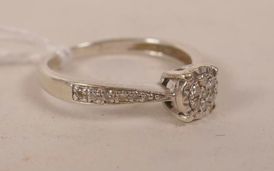 A 9ct white gold diamond cluster ring, approximate size...
