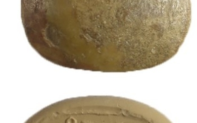 A BROWN STONE SCARABOID SEAL