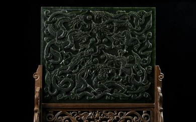 A CARVED SPINACH-GREEN JADE 'DRAGON' TABLE SCREEN.QING